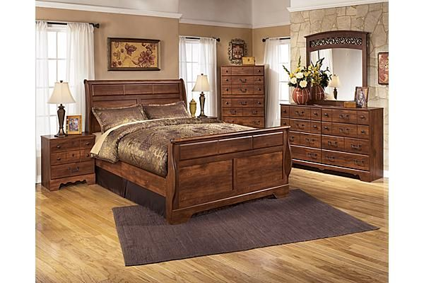 the timberline sleigh bedroom set from ashley furniture