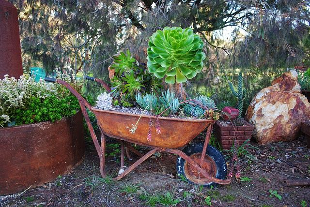 34 Way To Use That Old Wheelbarrow As A Planter Ideas And Pictures Wheelbarrow Planter Wheelbarrow Wheelbarrow Garden