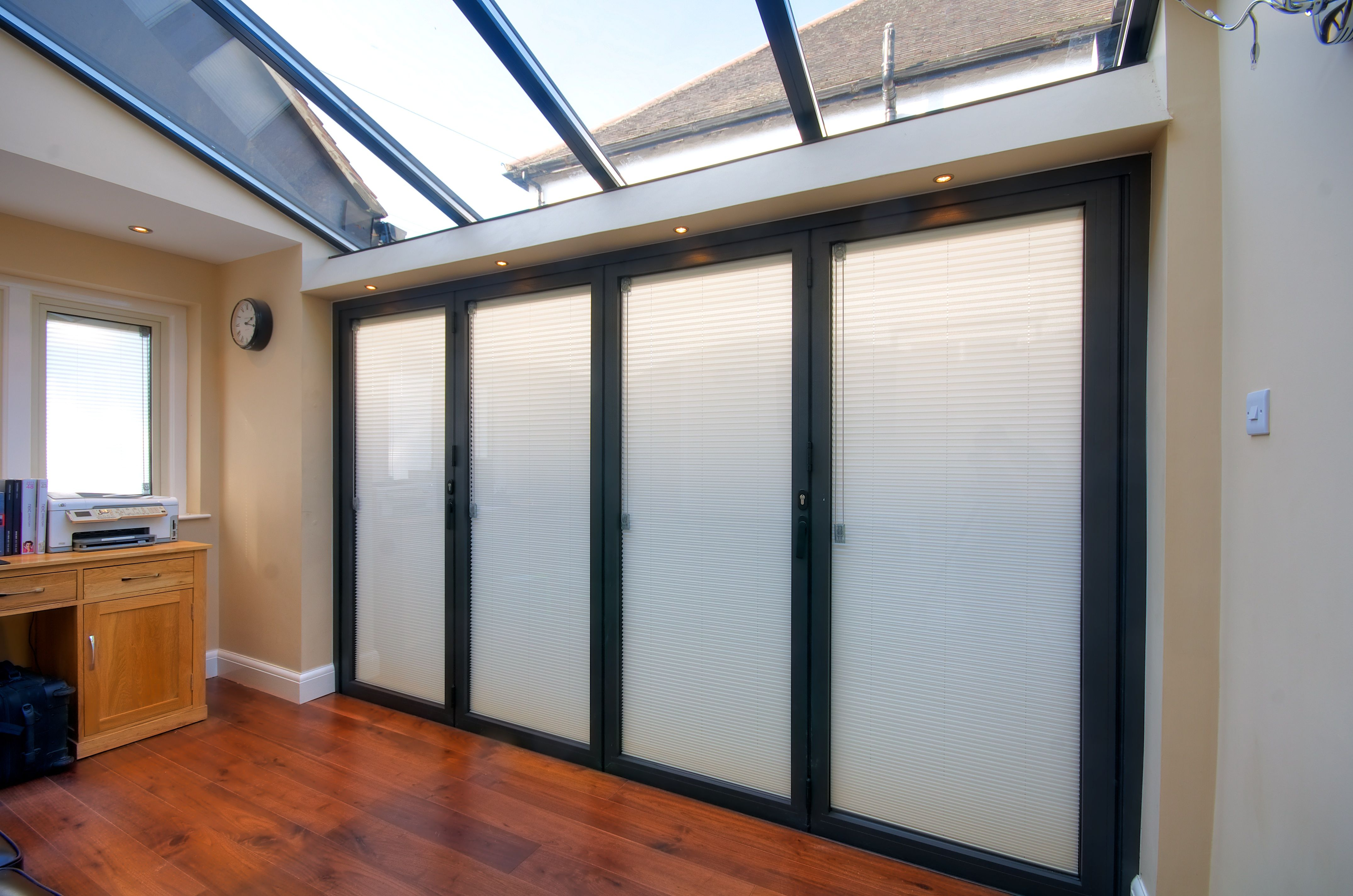 blinds glass sliding roller doors with floor to london interior sunscreen between french pin ceiling windows
