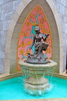 Cinderella fountain statue in Fantasyland in the Magic Kingdom. If you bend down, a crown appears on her head.