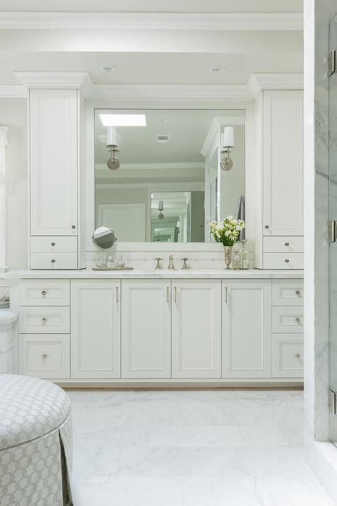bathroom features white shaker cabinets adorned 10374