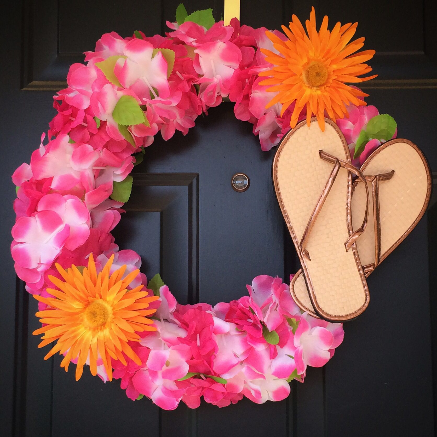 My very own flip flop wreath made with a pool noodle hawaiian leis made with a pool noodle hawaiian leis 2 flower clips and flip flops all from the dollar store 9 total i used strong tape to join izmirmasajfo Images