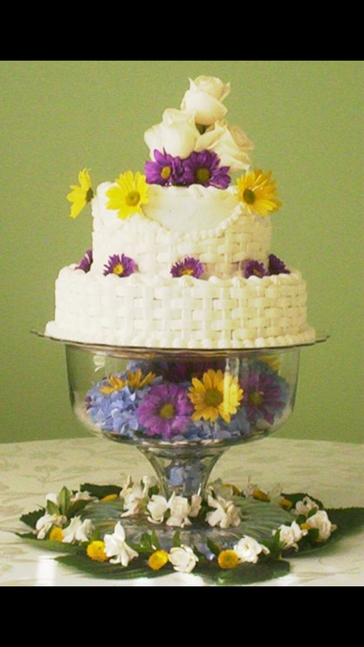 Wedding cake- basket weave, fresh flowers and twinkling lights in ...
