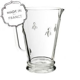 Sleek glass pitcher with a stately Napoleonic bee motif. Made in France.    Construction Material: Glass Color: Clear   Features:  Adorned with Napoleonic bee motif    Sturdy and heavy-duty enough for everyday use     Made in France  34 Ounce capacity