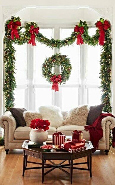 holiday decorating draped garland to accent the window