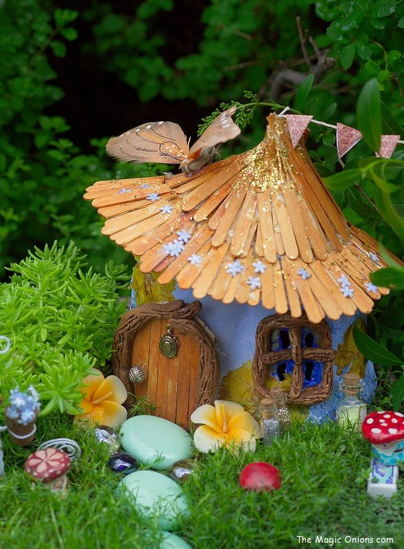 Fairy Houses from plastic containers cover with moss pebbles