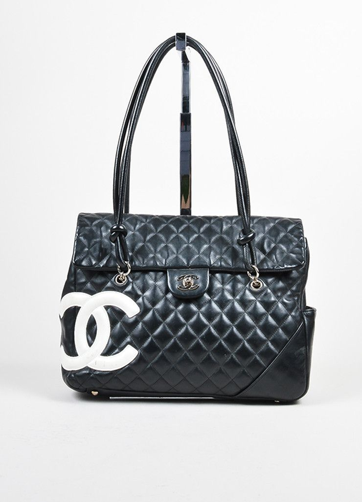 This Iconic Chanel Bag Is Constructed Of Black Quilted Lambskin Detailed With A White Cc Logo Ì Two Rolled Double Shoulder Straps