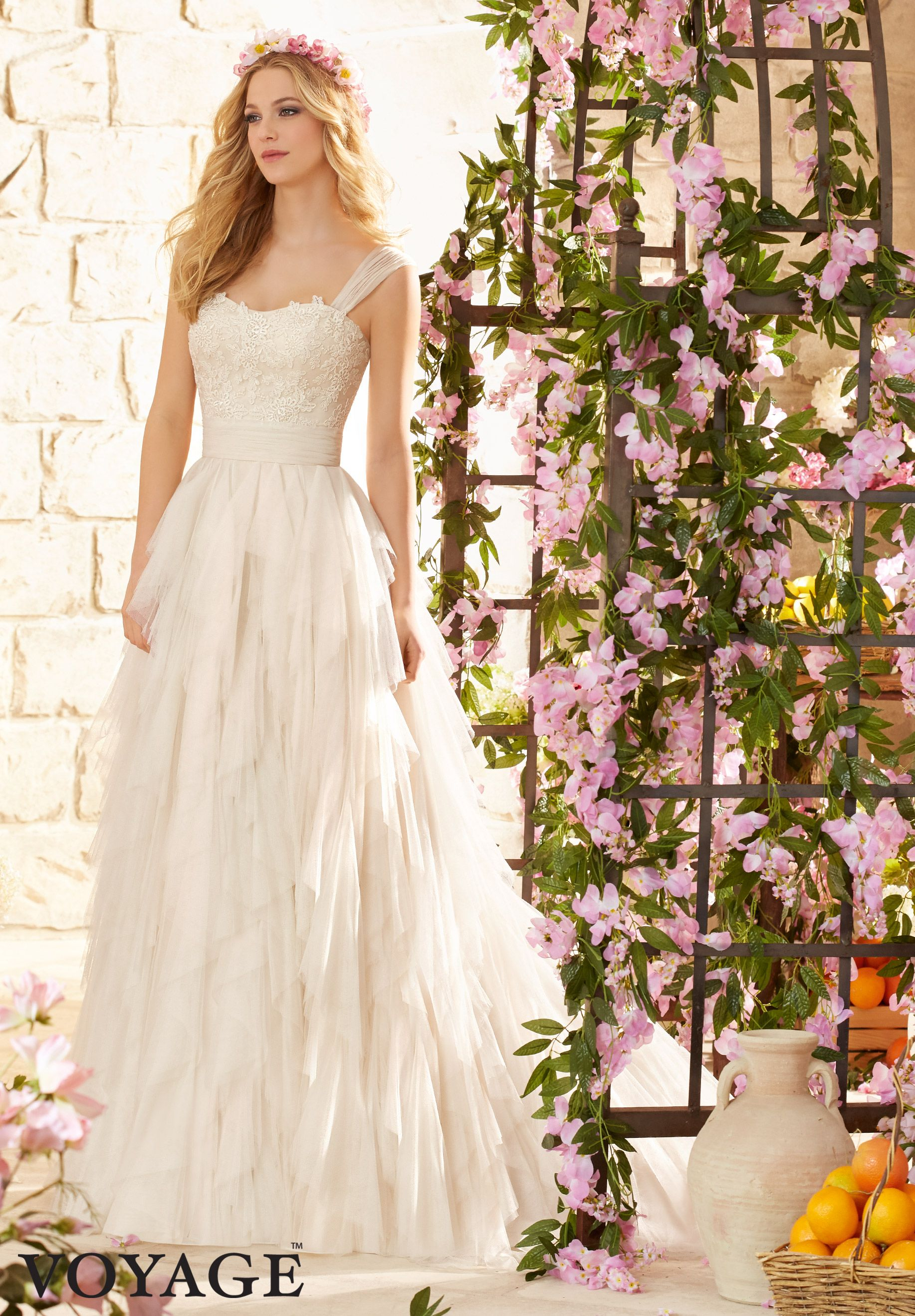 Color embroidered wedding dress  Wedding Dresses By Voyage featuring Embroidered Lace Appliques on