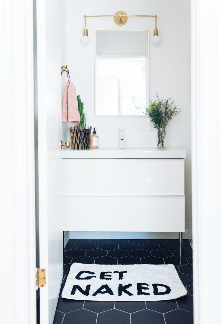 White vanity bathroom. IKEA vanity, brass sconce, black hex hexagon ...
