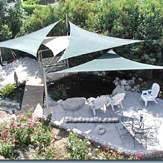 sun sails add a sculptural and shady solution to yards baked in the sun decor backyard. Black Bedroom Furniture Sets. Home Design Ideas