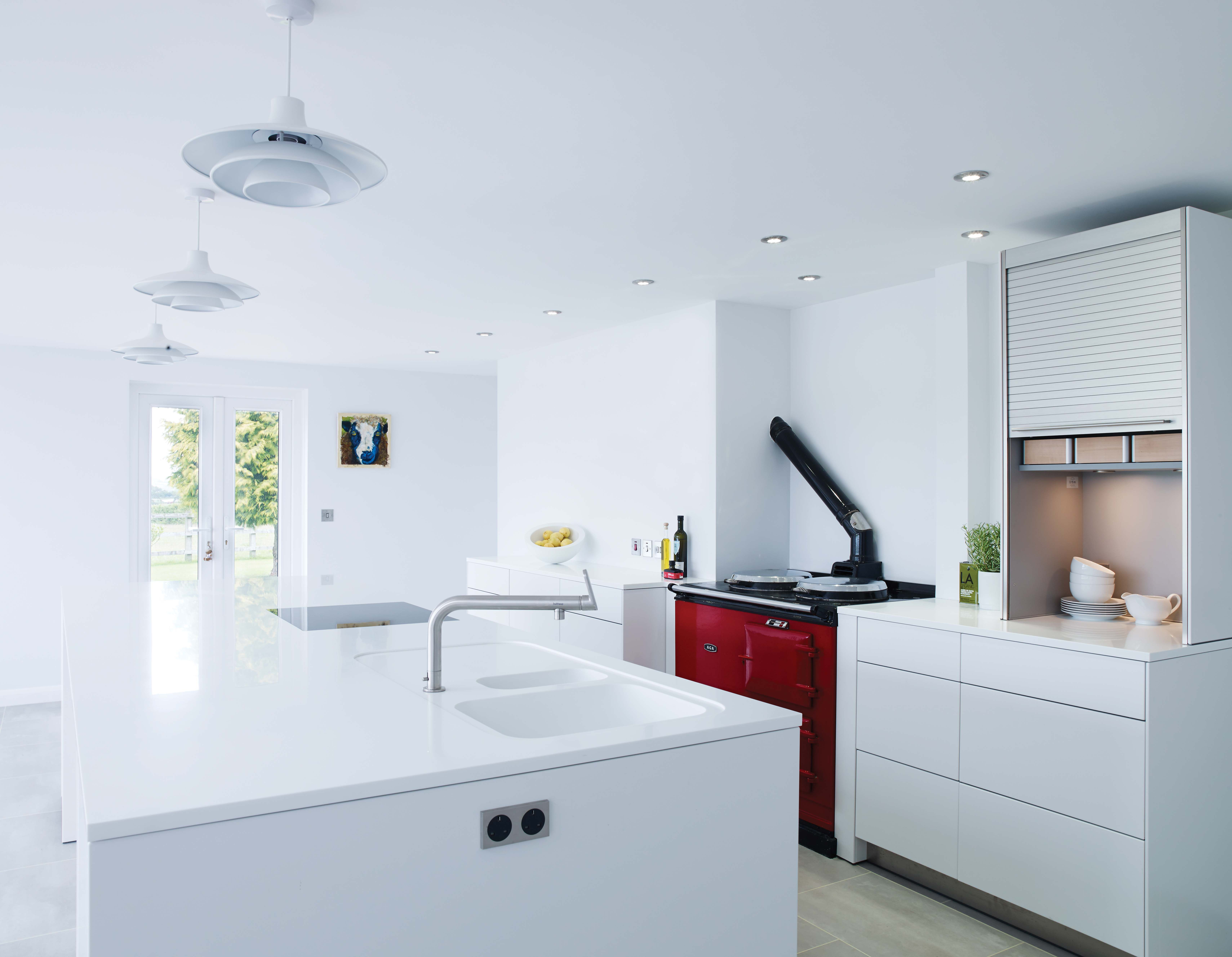 Contemporary, white bulthaup b3 kitchen with contrasting red ...