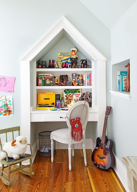 Vintage toys and cowboy boots sit on the shelves in this children's bedroom in Mike Wolfe's vintage-decorated home.