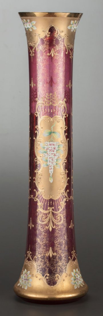 A Bohemian Moser (?) Ruby Glass, Floral and Gilt Overlay Vase THe Elongated Vase with Ruby and Gilt Speckled Ground and having Applied Flowers within Gilt Medallions Throughout 29 1/2 Inches in Height  Circa 1875