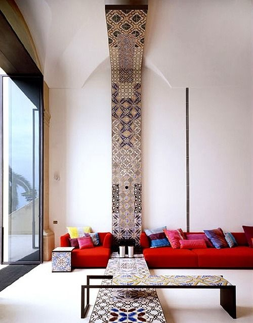 A tiled panel along the floor, wall and ceiling of this living room