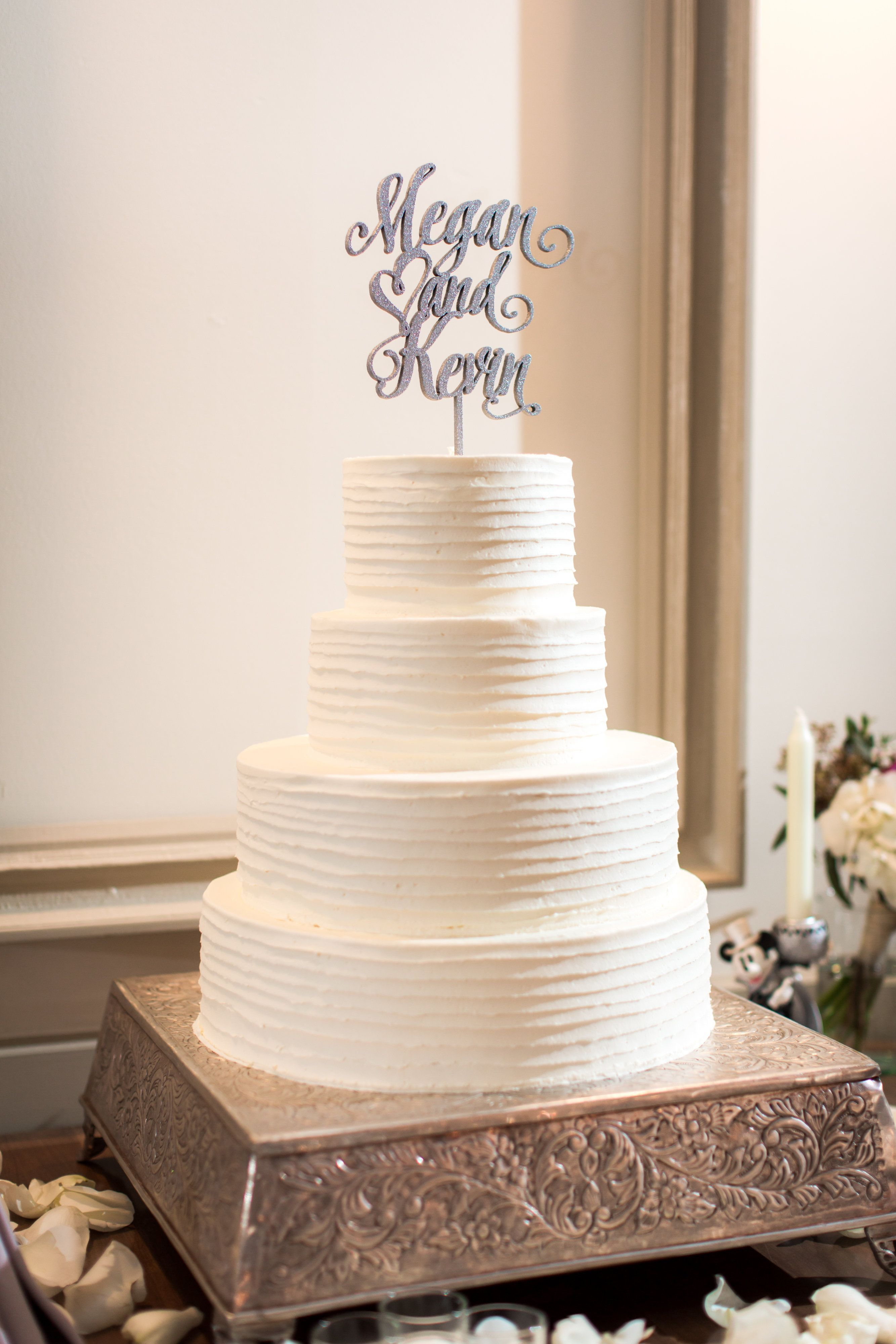 Tiered white wedding cake with silver topper   HollyHedge Estate ...