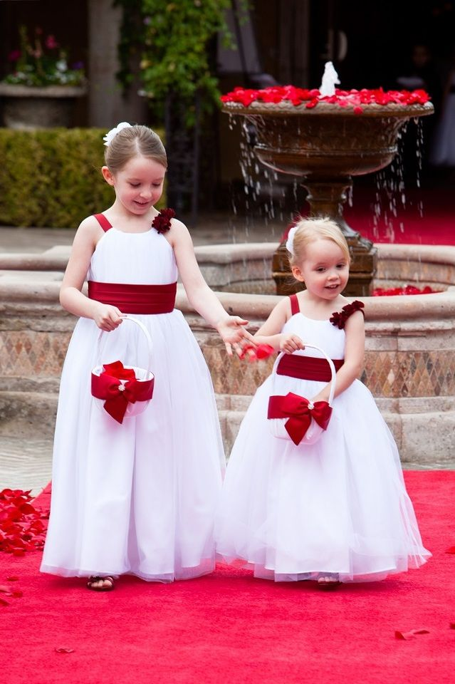 Flower Girls With White Tool Dresses And Red Rose Petals Walking