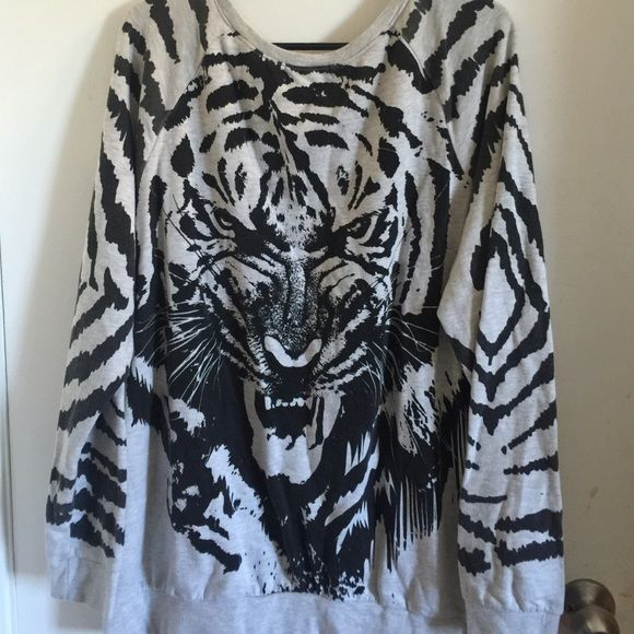 *Reduced Price* 3XL Forever21 Tiger Sweater Hello this is a 3XL Forever21 Tiger Sweater. Gently worn. In great condition. Make me an offer! :) Forever 21 Sweaters Crew & Scoop Necks
