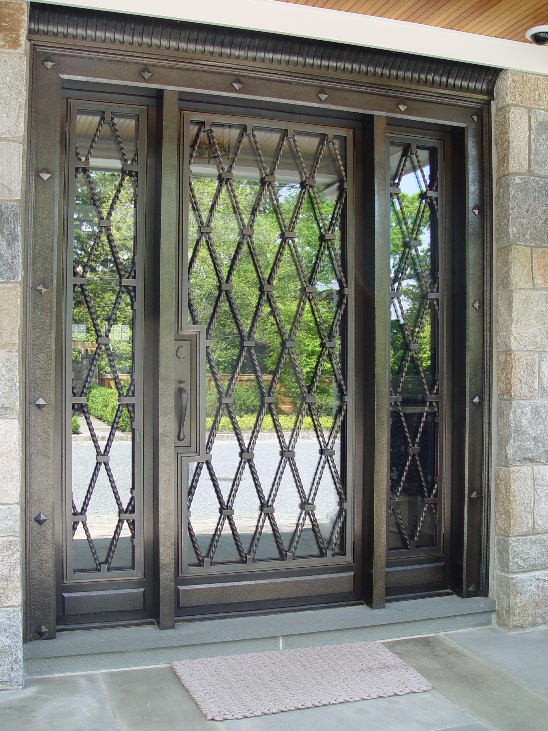 Custom Bronze Entry Door With Hinged Grilles Custom