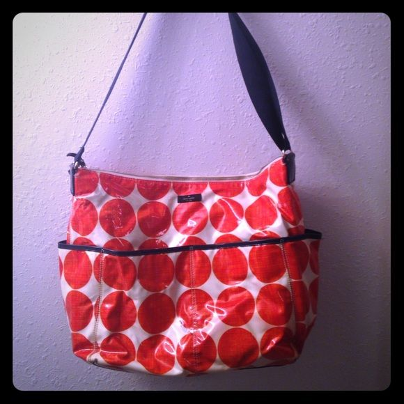 Kate Spade Diaper Bag Kate Spade. Diaper bag. Red navy blue and white. Inside has no tears, stains or rips looks brand new inside. Adjustable strap. Pockets all around the outside. Compartments inside too. The only small stain is shown in the picture on the right side bottom of the bag, and also a little on the left side on the bottom. Zipper works but fabric on it is ripped a bit. Other than that good condition. Best offers! kate spade Bags Baby Bags