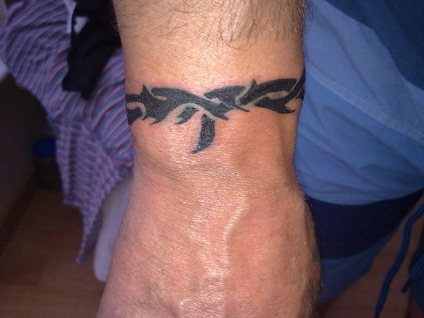 Wrist Tattoo tribal by Dabull04