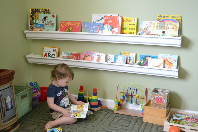 diy rain gutter bookshelves. looks like a fun play room or classroom idea.
