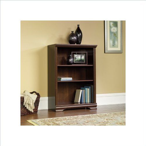 """Sauder Carolina Estate 3-Shelf Bookcase in Select Cherry by Sauder. $79.95. Contoured feet and raised frame. Ships ready to assemble. Three shelves (two are adjustable). This bookcase is a practical addition to any home or office. Featuring two adjustable shelves, this bookcase will add style and storage to any room. Select Cherry finish. Features: Finish:Select Cherry Two adjustable shelves. Specifications: Overall Dimension:41.75"""" x 29.37"""" x 13.75"""" Weight: 54 lbs. Save 33%!"""