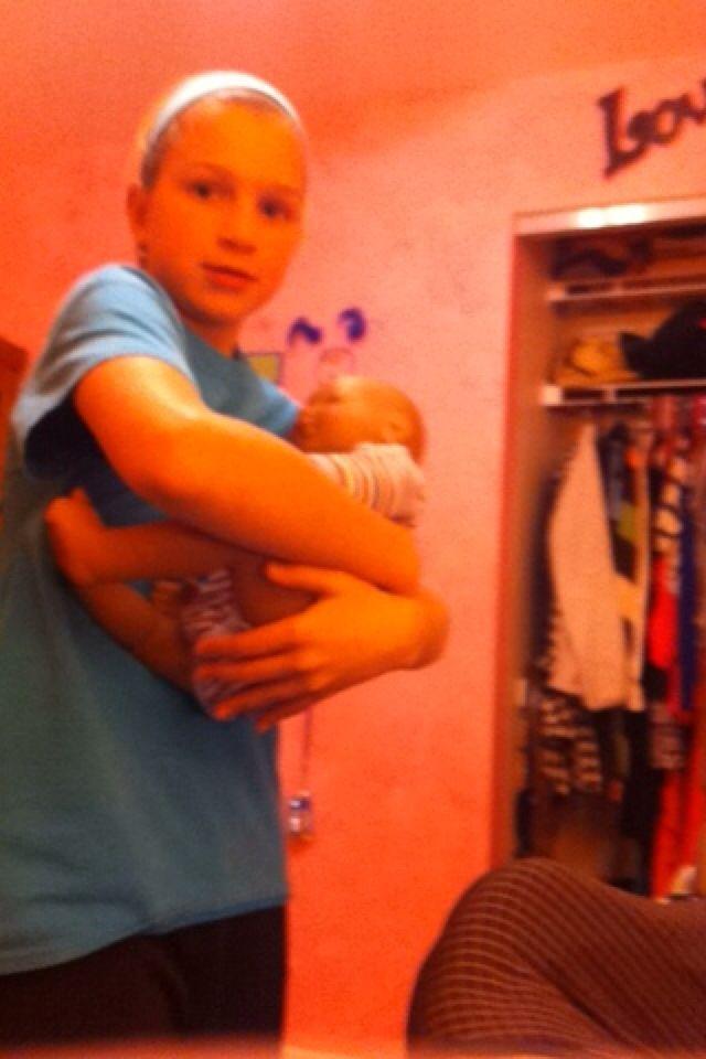 Alyssa holding baby