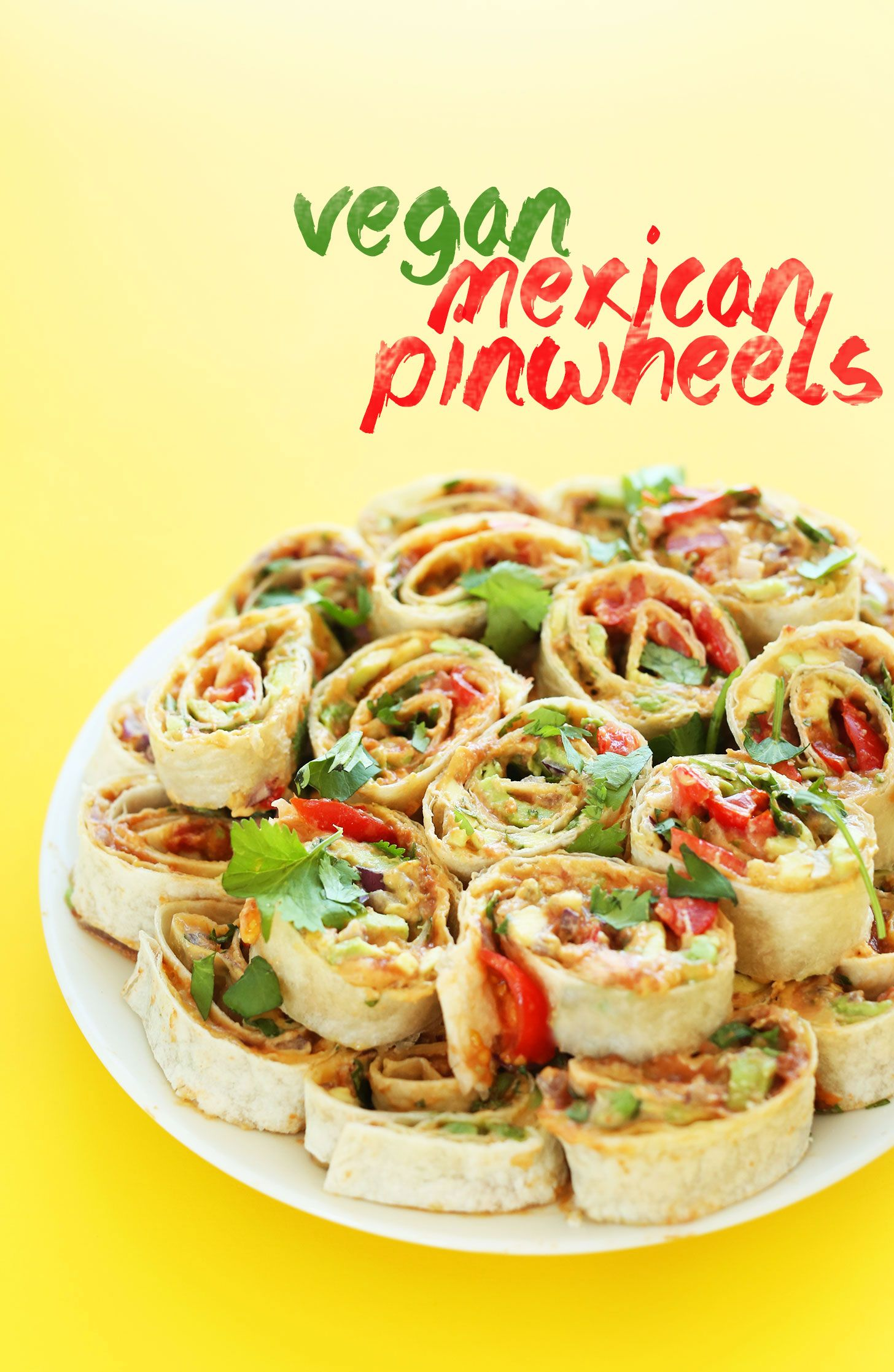 AMAZING Mexican Pinwheels with Refried Beans, Avocado, Onion, Cilantro and Tomato! Such a delicious #vegan friendly finger food! #recipe #healthy #snack #mexican #minimalistbaker