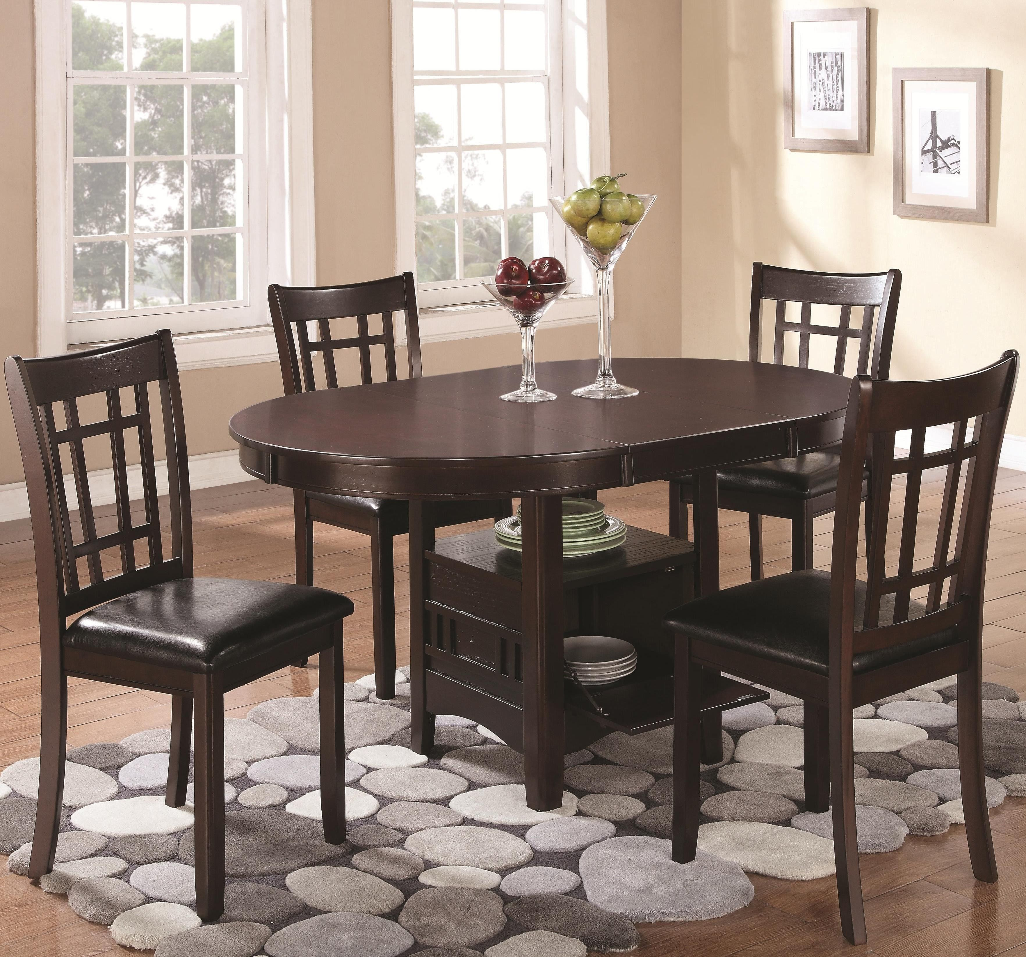 The table in this set features an elegant oval top with an 18     The table in this set features an elegant oval top with an 18 extension  leaf and a storage base where you can display decorative pieces