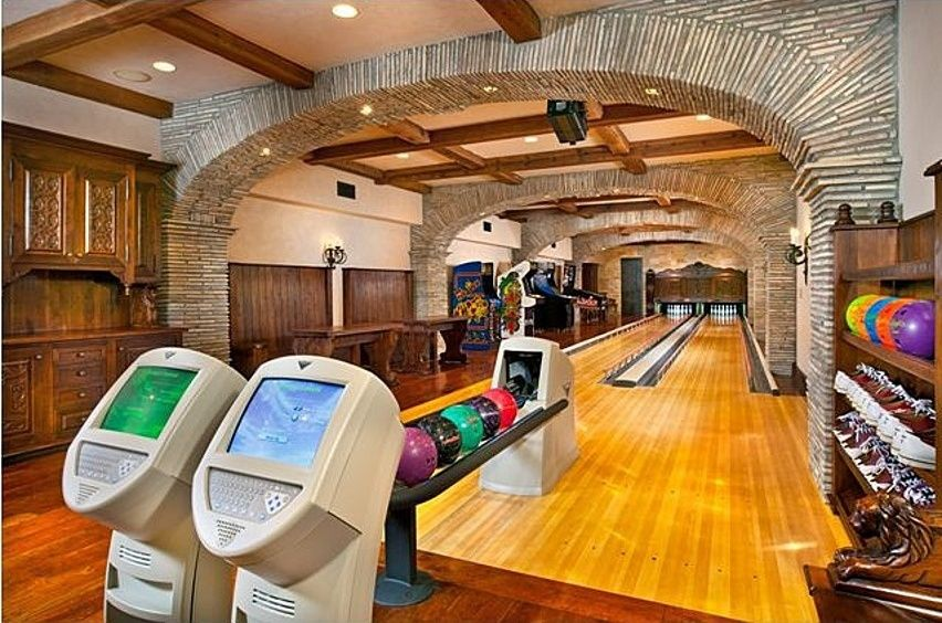 mediterranean game room with pac man arcade machine stone archway wall sconce recessed gameroom lighting