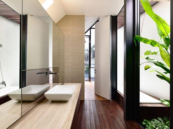 Faber terrace residence slatted timber screen covers entire side elevation preserve privacy 22