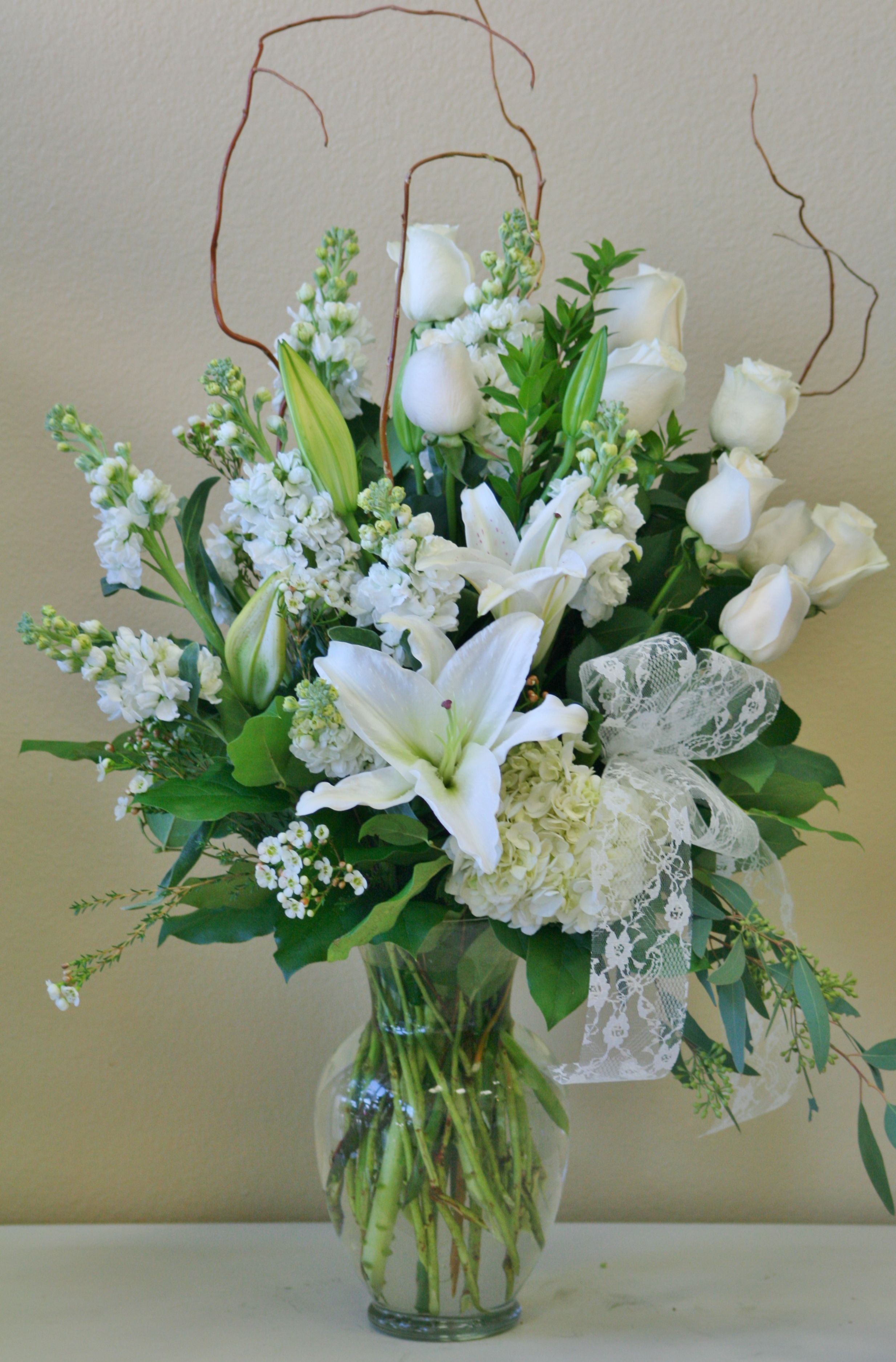 This Is An Arrangement Of All White Flowers Including White
