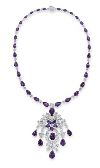A FINE ALEXANDRITE AND DIAMOND PENDENT NECKLACE/BROOCH   The detachable pendant designed as a diamond foliate cascade with alexandrite flower head centre and drop-shaped terminals to the graduated pear-shaped alexandrite and brilliant-cut diamond necklace, the pendant may also be worn as brooch, 41.0 cm long