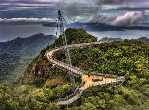 Just stumbled upon the Langkawi Sky Bridge, would love to walk that some day!    From Wikipedia:  Langkawi Sky Bridge is a 125 metres (410 ft) curved pedestrian cable-stayed bridge in Malaysia. It is located 700 metres (2,300 ft) above sea level at the peak of Gunung Mat Chinchang on Pulau Langkawi, an island in the Langkawi archipelago in Kedah. The last scene of Indian movie Don: The Chase Begins Again was filmed here.