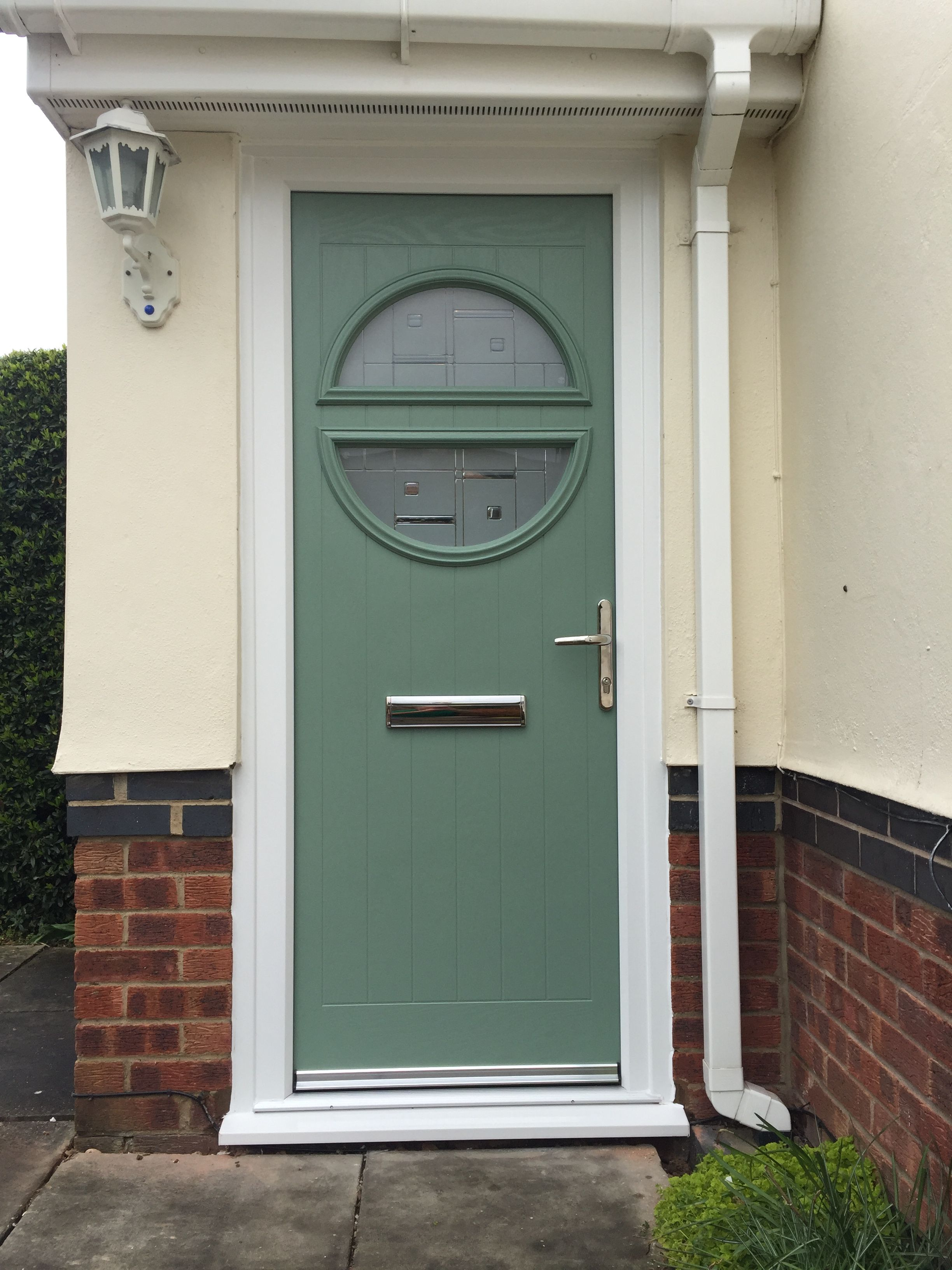 Chartwell green composite door in a white upvc frame for Composite double glazed doors