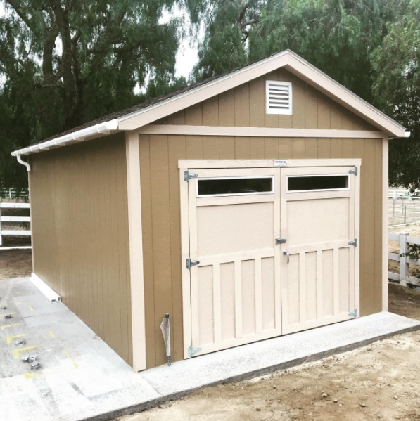 Double Doors Wainscot Trim And Transom Windows This Storage Shed Came With Style Shed Construction Shed Storage Shed