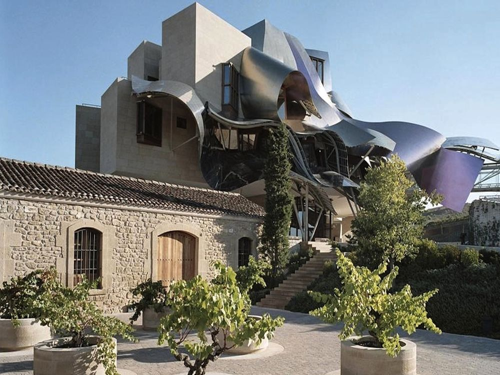♻ Marqués de Riscal Hotel is an insane piece of engineering; it was only natural that the renowned Spanish wine region should turn to Frank Ghery to make an architectural statement promoting its wines. That statement came in the shape of a complex building the architect designed to incorporate the character of the region and its vintage through a multi-coloured ribbon like facade reflecting the pink hues of Rioja, the silver foil shielding the cork, and the distinctive mesh which adorns all…