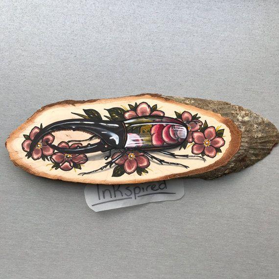 Wood slice with an original drawing of a hercules door Inkspirednl