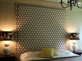 Large upholstered headboard mounted to wall, nailhead trim