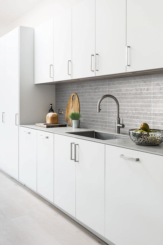 gray backsplash white cabinets