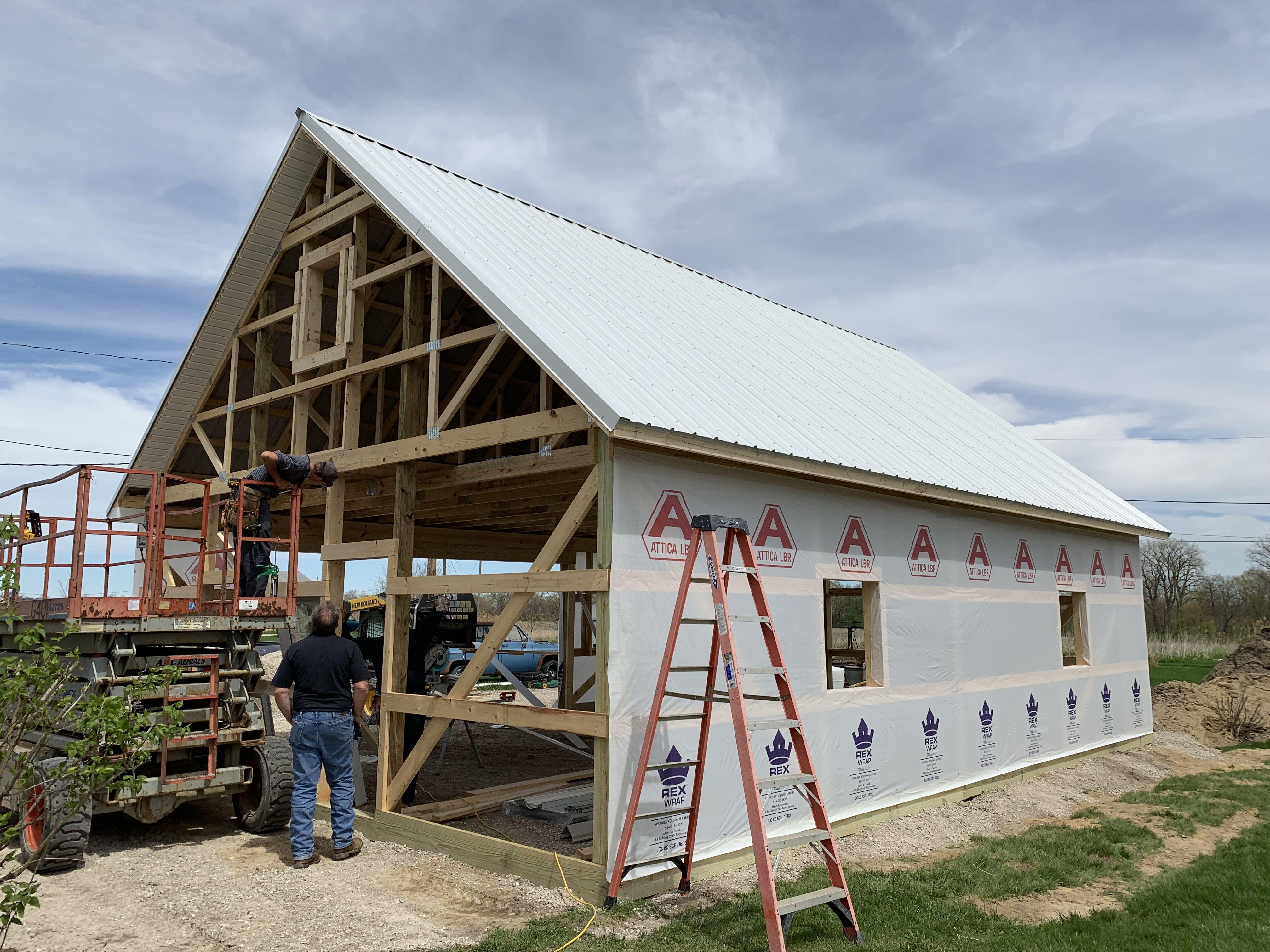 10 12 Pitch In Process Pole Barn Pole Barn Post Frame Building Pole Barn Garage