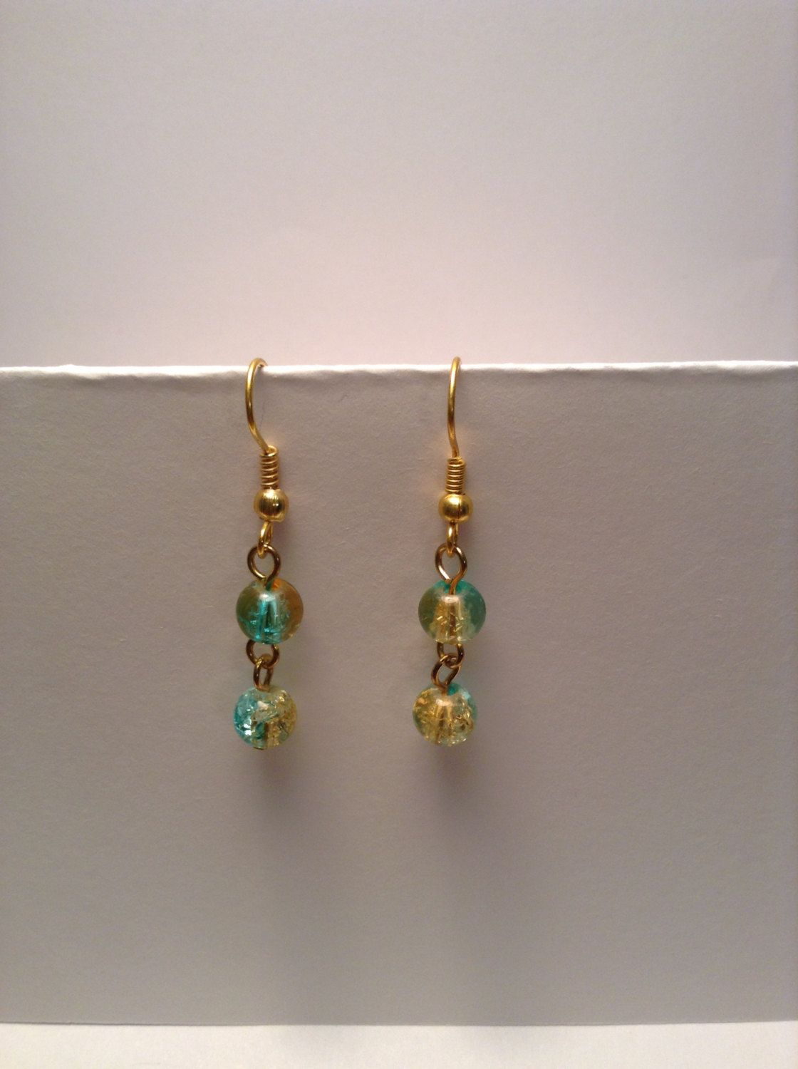 Blue and gold cracked glass dangle earrings by Shaylasjewelrybox on Etsy