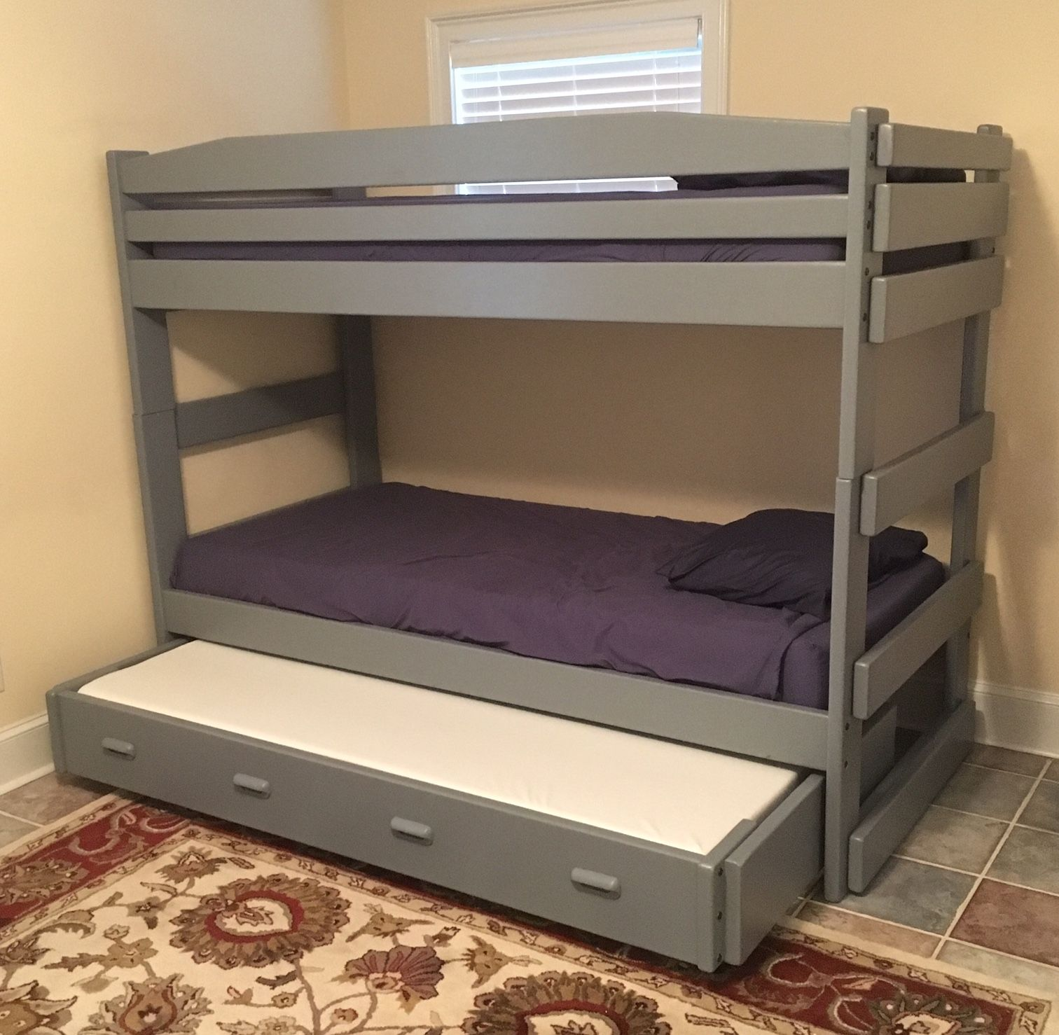 Twin stackable bunk with trundle sleeps three in the space of one
