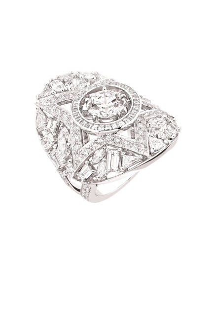 The 1932 Collection  Another Etoile Filante ring, set in 18K white gold with a two-carat round-cut diamond, 29 fancy- cut diamonds, 83 brilliant-cut diamonds, and 29 princess-cut diamonds.