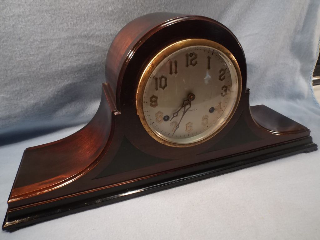 this vintage walnut mahogany camelback tambour mantle clock has