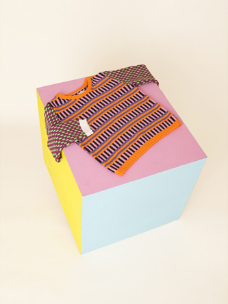 Annie Larson's sweater. Combining graphic art and hapiness! We LOVE!