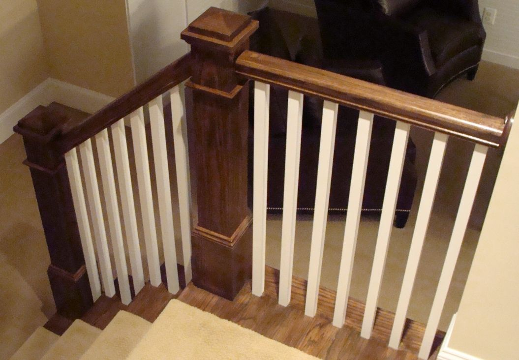 Square newel posts; two toned stairs Doors, trim and