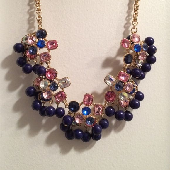 BRAND NEW Multicolored statement necklace Statement necklace with gold detailing and adjustable chain. Bought from a local boutique and never worn. New with tags- originally $32 Jewelry Necklaces