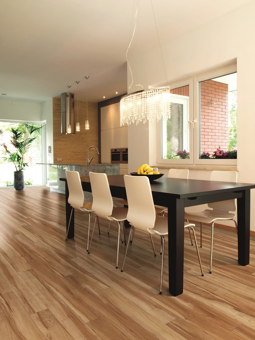 The floor in this stunning dining area is actually vinyl luxury vinyl plank in color red river hickory from us floors and available at innovative flooring