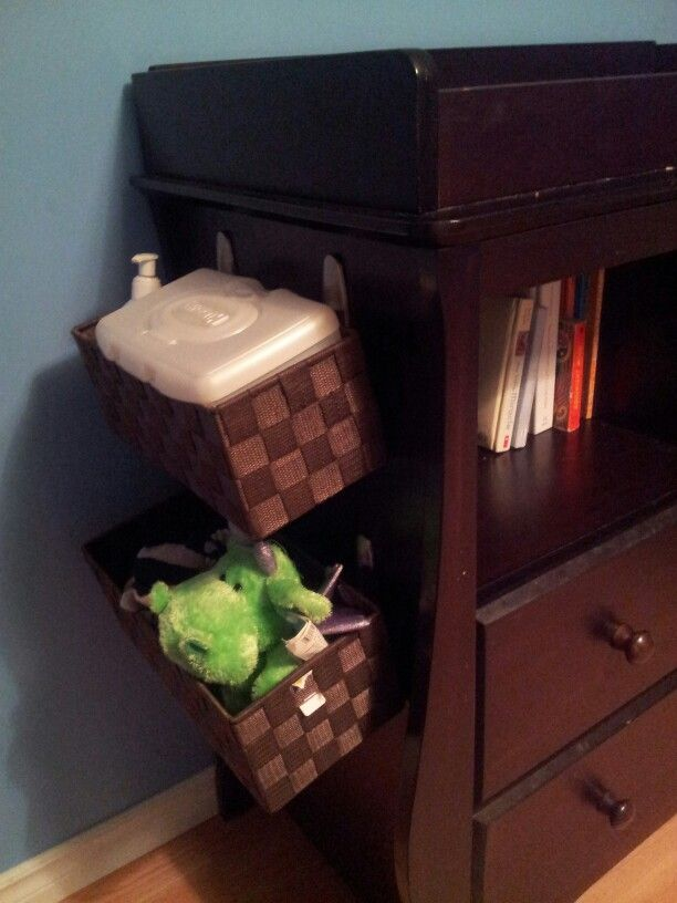 Use Hooks And Dollar Store Baskets To Turn Any Dresser Into A Change Table.  Space For Wipes, Cream And Toys To Keep Baby Occupied!